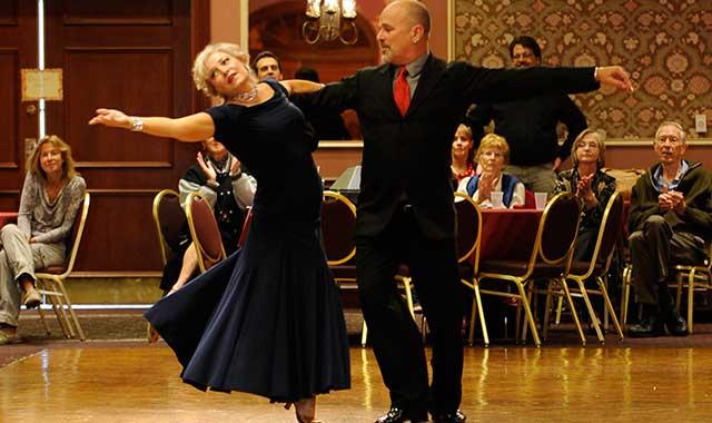 Linda Burton with John Abrams.