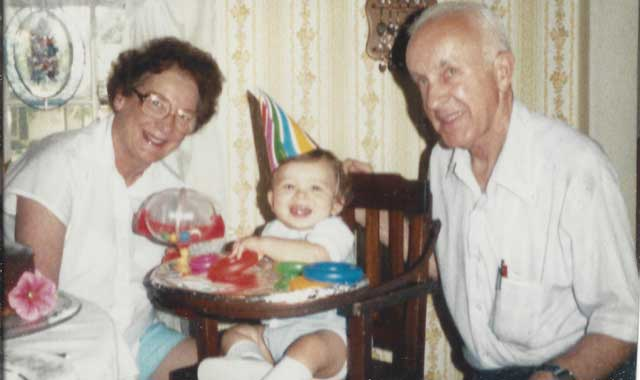 """Janine: """"Mom and Dad with my son Blake, on his first birthday in 1990. Blake is now Graphics Director at Northwest Quarterly Magazine. He played many a mean game of Scrabble with his foxy Grandma, right up to the month she died."""""""