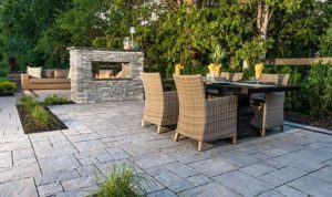 Outdoor living spaces like this are increasingly popular in local backyards. This one features materials from Benson Stone Company.