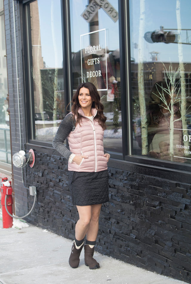 Light, lacey base shirt by Prana Darla, worn under a wool/acrylic sweater by Prana Julien and a windproof down vest by Prana Lyra. Worn with a fleece-lined skirt by Prana Diva and insulated boots by Oboz Madison. Available at Rocktown Adventures, in Rockford.