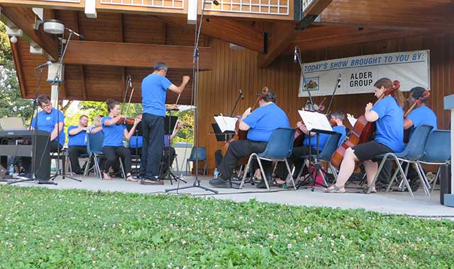 Director Ian Nie leads the Turtle Creek Chamber Orchestra, which is made up of doctors, teachers, business owners and anyone else who has a love for music.