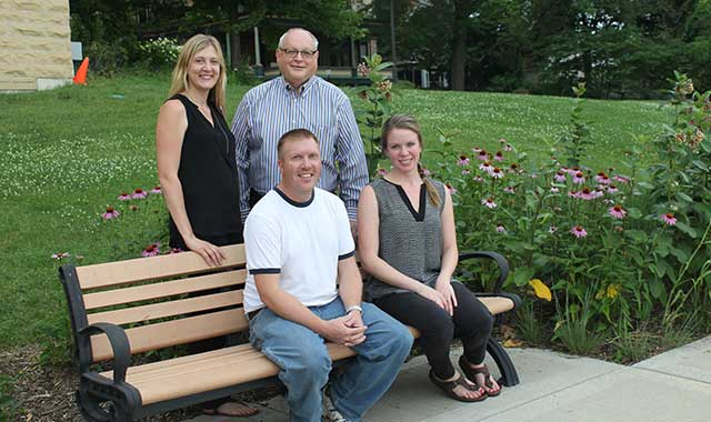 Burpee's dynamic new leadership team. Standing are Anne Weerda, executive director, and Dennis Harezlak, president of the board of trustees. Seated are Joe Mathews, director of paleontology, and Alexandra Koch, education director.