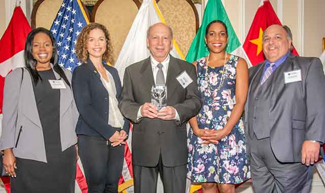 Dr. Rick Serola, Founder & Co-CEO of Serola Biomechanics, accepts the Governor's Export Award with (left to right) DaShanda Mosley, the firm's director of marketing and business development; Erin Guthrie, Acting Director of Illinois' Department of Commerce and Economic Opportunity; Lt. Governor Juliana Stratton; and Stephen G. Kadamian, the firm's director of strategic planning and management for Serola Biomechanics.