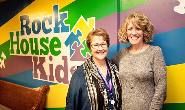Volunteer Gloria Visel and Executive Director Deanna Lacny help provide a nurturing environment to inner-city children at Rock House Kids.